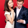 Woman and man looking at cellphone — Stock Photo