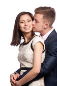 Man kissing his wife's cheek — Stock Photo