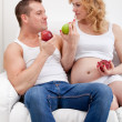 Stock Photo: Couple posing with apples
