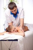 Masseur is massaging female — Stock Photo