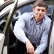 Stock Photo: Young man in a car