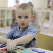 Постер, плакат: Little boy in kindergarten
