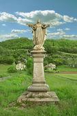 Statue of jesus in rural landscape — Stock Photo