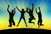 Happy jumping in joy on a sunset background — Stock Photo