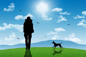 Lonely backpackers with a dog on top of a hill with mountains on — Stock Photo