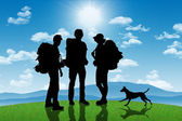 Group of backpackers with a dog on a hill with mountains on back — Stock Photo