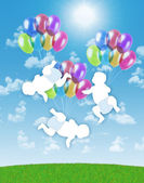 Newborn triplets flying on colorful balloons in the sky — Stock Photo