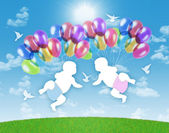 Newborn twins flying on colorful balloons in the sky — Stock Photo