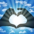 Heart made with fingers on blue sky background — Foto Stock