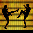 Two man fighting on a fire background — Stockfoto