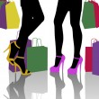 Two women with lots of colorful shopping bags — Stock Photo