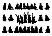 Big set of schoolchildren seated silhouettes  — Stock Photo