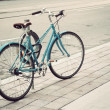 Women's bicycle parked on the street — Stock Photo #34580163