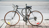 Bicycle parked on the street — ストック写真