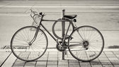 Bicycle parked on the street — Stockfoto