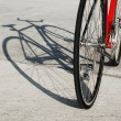 Bicycle standing in the parking lot and its shadow — Stock Photo