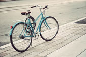 Women's bicycle parked on the street — Stockfoto