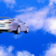 Car speed motion blurred — Stock Photo