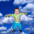 The boy flies in clouds — Stock Photo