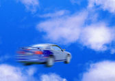 Car speed motion blurred blue — Stock Photo