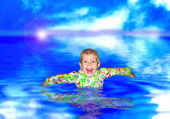 The boy bathes in water — Stock Photo