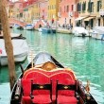 Venice: traditional gondola waiting for a romantic ride — Stock Photo #24759551