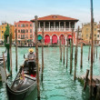 Venice: traditional gondola waiting for a romantic ride — Stock Photo #24759583