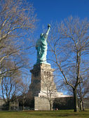 New York: Unusual rear view of the Statue of Liberty, an American symbol. Liberty Island, New York City, USA — Stock Photo