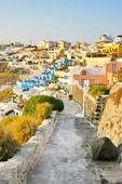 Santorini, grecia: vista del atardecer de fira, la capital. — Foto de Stock