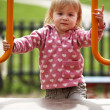 Little girl outside on playground playing with her mother — Stock Photo #30713033