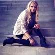 Young blonde beautiful lady on city stairs posing for beauty shots — Stock Photo