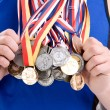 Sports man with lot of medals — Stock Photo