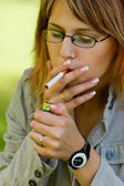 Girl outdoor smoking cigarettes — Stock Photo