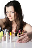 Lady with some pieces of cosmetics — Stock Photo