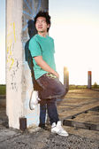 Young Asian boy posingfor stylish photos in ruins of building — Stockfoto