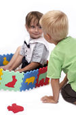 Children at play with set of rubber foam toys — Stock Photo