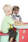 Children at play with color foam toys — Stock Photo