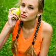Stock Photo: Young lady with apple