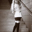 Young blonde beautiful lady on city stairs posing for beauty shots — Stock Photo #30723737