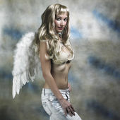 Blonde angel in studio — Stock Photo