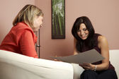 Consultant and client in home — Stock Photo