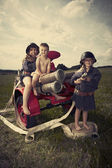 Group of children posing in retro — Stock Photo