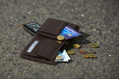 Lost wallet and phone at the park sidewalk — Stock Photo
