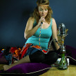 Young woman smoking hookah — Foto de Stock