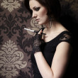 Nice lady model posing as a cigarette smoker — Stock Photo