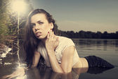 Young female model in summer time by the lake — Stock Photo