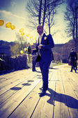 Groom with a bottle of champagne — Stock Photo
