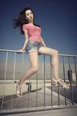 Brunette girl posing in city — Stock Photo