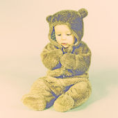 Kid in a bear suit — Stock Photo