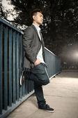 Asian man posing on the bridge — Stok fotoğraf